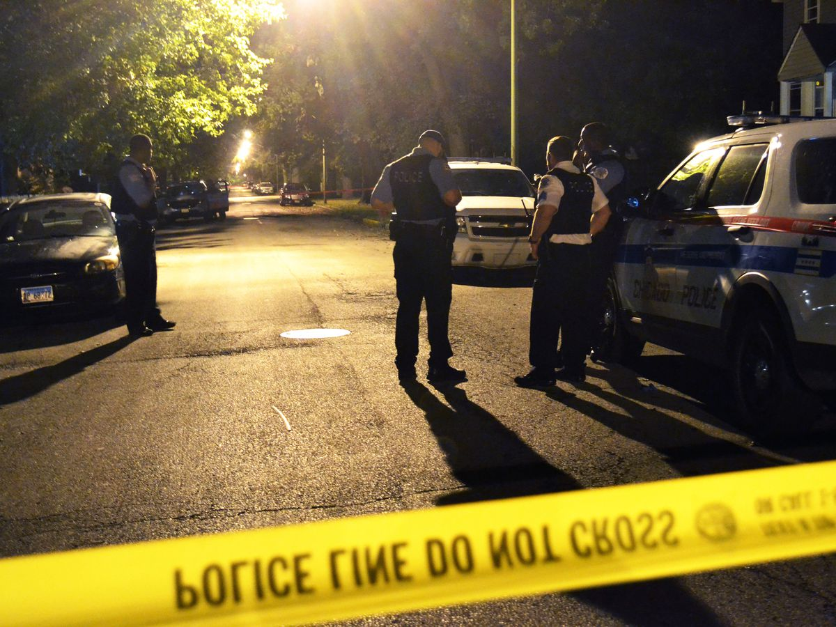 Police investigate a shooting about 11:30 p.m. Saturday, August 18, 2018 in the 11600 block of South Yale Avenue in Chicago. | Justin Jackson/ Sun-Times