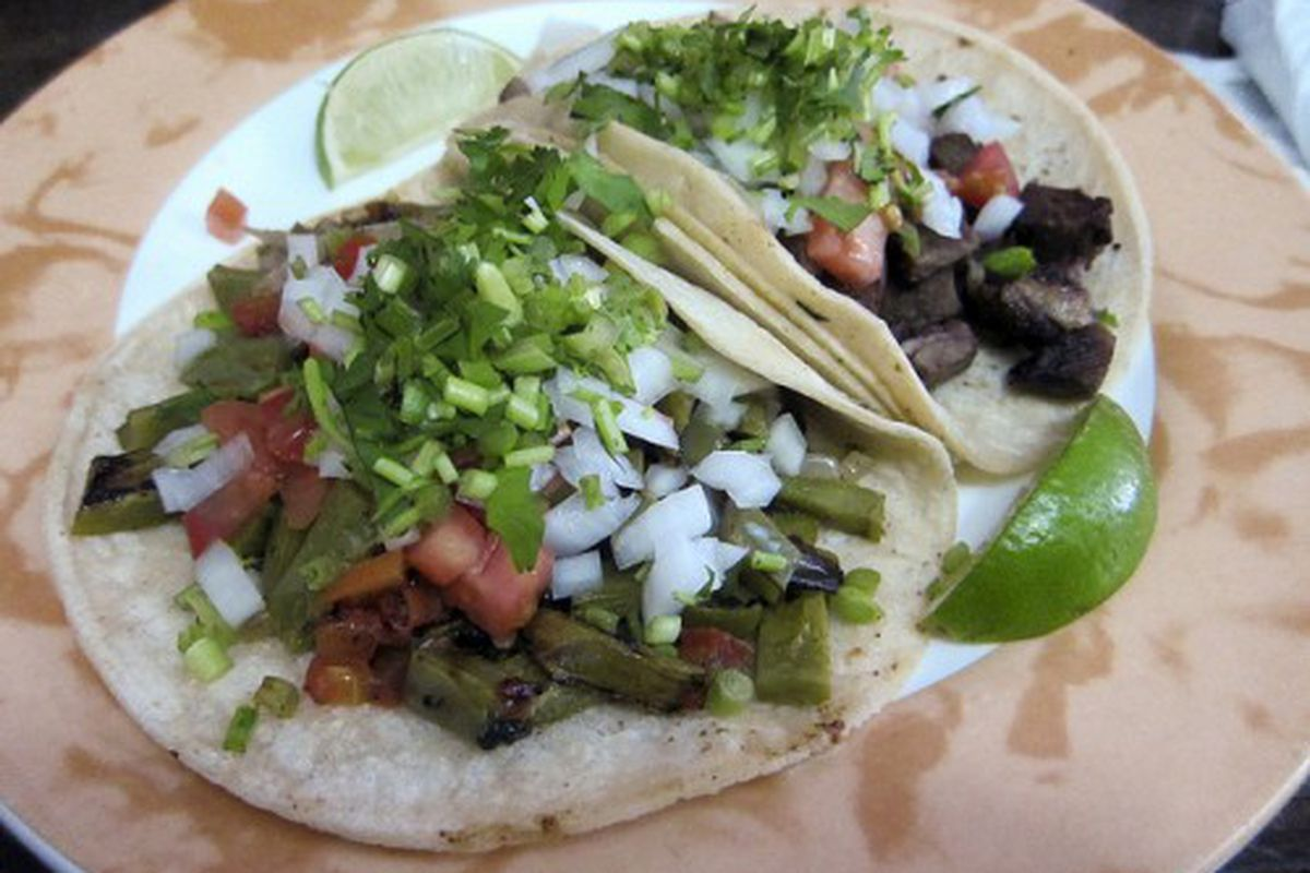 """Cactus taco and lengua taco at Taqueria Y La Fonda by <a href=""""http://www.flickr.com/photos/50772153@N07/5915204646/in/pool-eater/"""">CarbZombie</a>."""