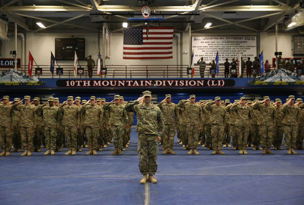 US Army soldiers salute during a welcome-home ceremony after from Iraq on May 17, 2016 at Fort Drum, New York.
