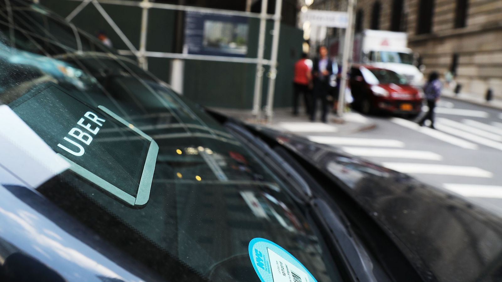 Uber is curbing its losses and growing its business while it searches for a new CEO