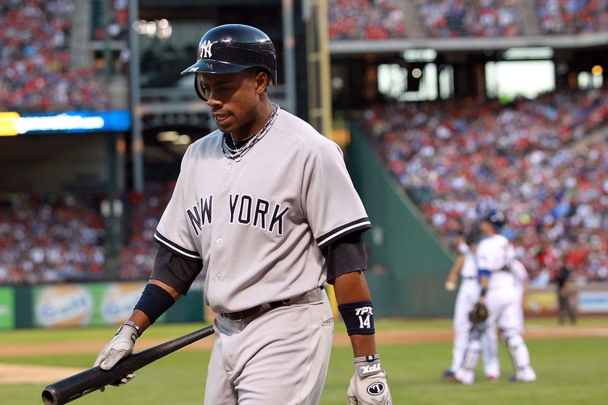 ARLINGTON, TX - APRIL 24:  Curtis Granderson #14 of the New York Yankees walks off after striking out against the Texas Rangers at Rangers Ballpark in Arlington on April 24, 2012 in Arlington, Texas.  (Photo by Ronald Martinez/Getty Images)