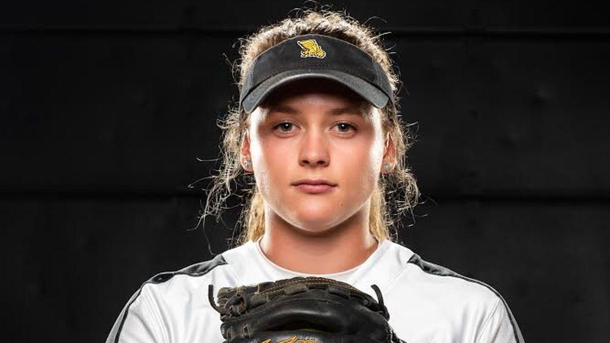 Emma Hoffart in a softball uniform