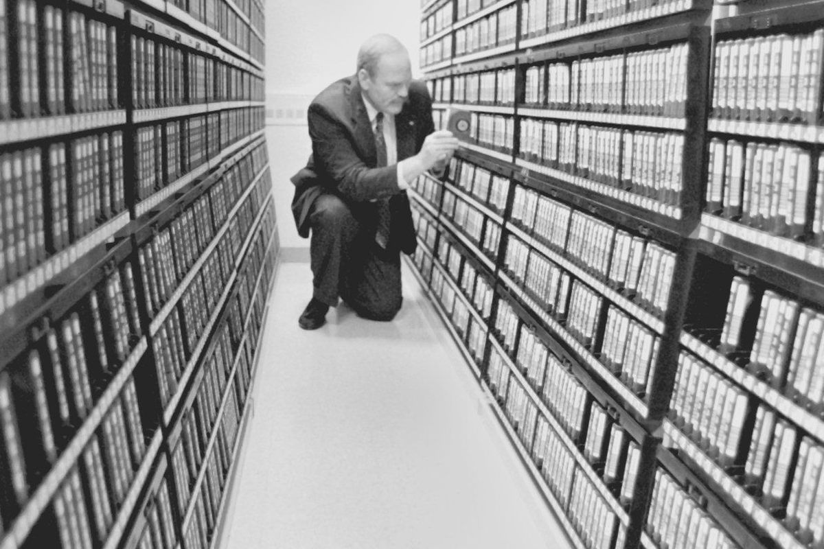 10/5/95- - Photo of Steve Whitney retrieving a tape cartridge from the tape storage library. 50,000