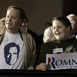 Peter Galamaga, left, and his son, Timothy, wait for Republican presidential candidate, former Massachusetts Gov. Mitt Romney at an election night rally in Manchester, N.H., Tuesday, April 24, 2012. (AP Photo/Jae C. Hong)