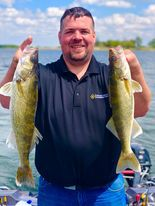 Matt Schmit holds a pair of 23-inch walleye from Heidecke Lake. Provided by Mike Hanson