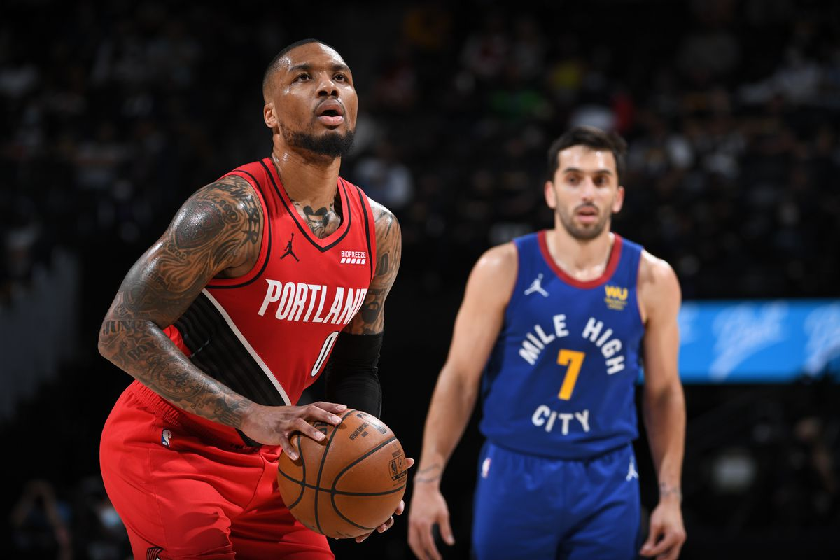 Damian Lillard of the Portland Trail Blazers shoots a free throw during the game against the Denver Nuggets during Round 1, Game 1 of the the 2021 NBA Playoffs on May 22, 2021 at the Ball Arena in Denver, Colorado.