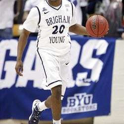 Brigham Young Cougars guard Anson Winder (20) dribbles up court in Provo  Thursday, Jan. 3, 2013.