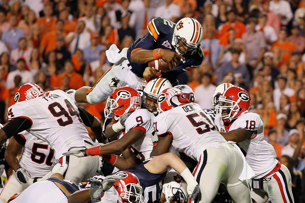 AUBURN AL - NOVEMBER 13:  Quarterback Cameron Newton #2 of the Auburn Tigers dives across the defense for a touchdown against the Georgia Bulldogs at Jordan-Hare Stadium on November 13 2010 in Auburn Alabama.  (Photo by Kevin C. Cox/Getty Images)