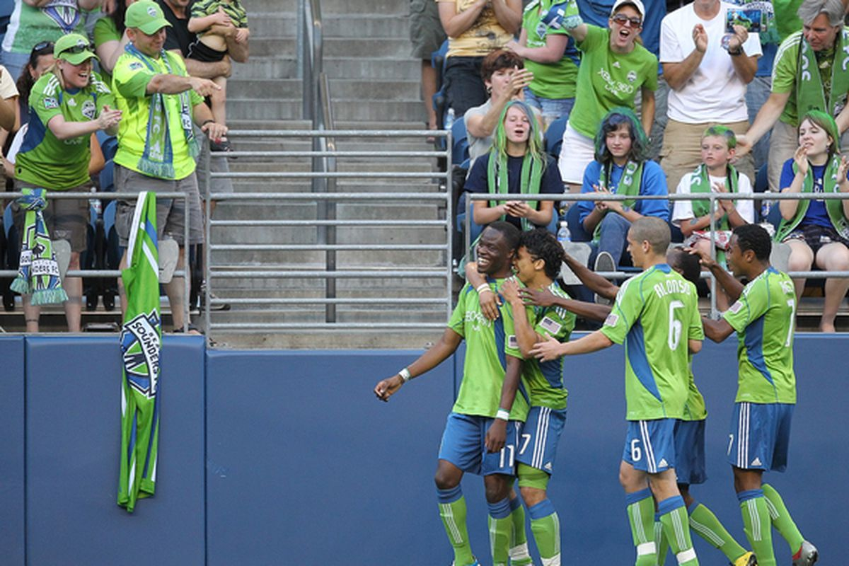 How often will we see Steve Zakuani and Fredy Montero celebrate this year? (Photo by Otto Greule Jr/Getty Images)