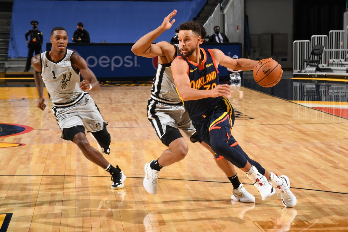 Stephen Curry of the Golden State Warriors dribbles the ball during the game against the San Antonio Spurs on January 20, 2021 at Chase Center in San Francisco, California.