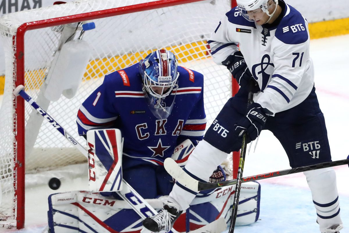 ST PETERSBURG, RUSSIA - SEPTEMBER 28, 2019: SKA St Petersburg's goaltender Alexei Melnichuk (L) and Dynamo Moscow's Ivan Muranov in a 2019/2020 KHL Regular Season ice hockey match between SKA St Petersburg and Dynamo Moscow at Ledovy Dvorets Arena (Ice Palace).
