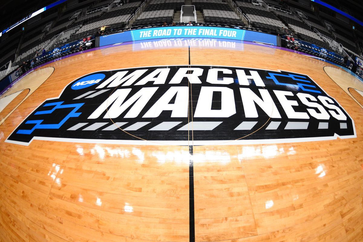 The march madness logo on the court before the game between the Kansas State Wildcats and the UC Irvine Anteaters in their NCAA Division I Men's Basketball Championship first round game on March 22, 2019, at SAP Center at San Jose in San Jose, CA.