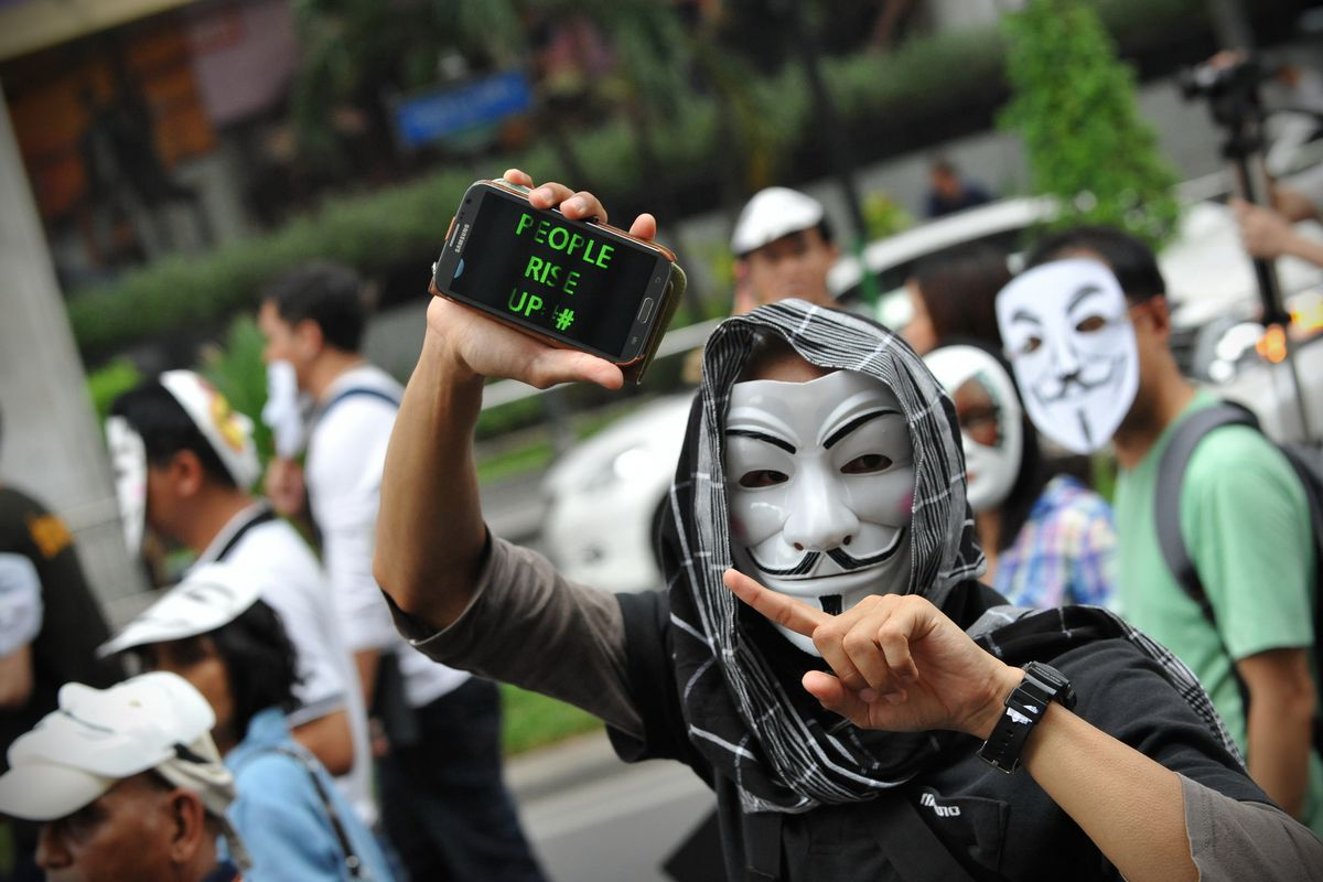 Members of Anonymous like to wear a Guy Fawkes mask like this in public.