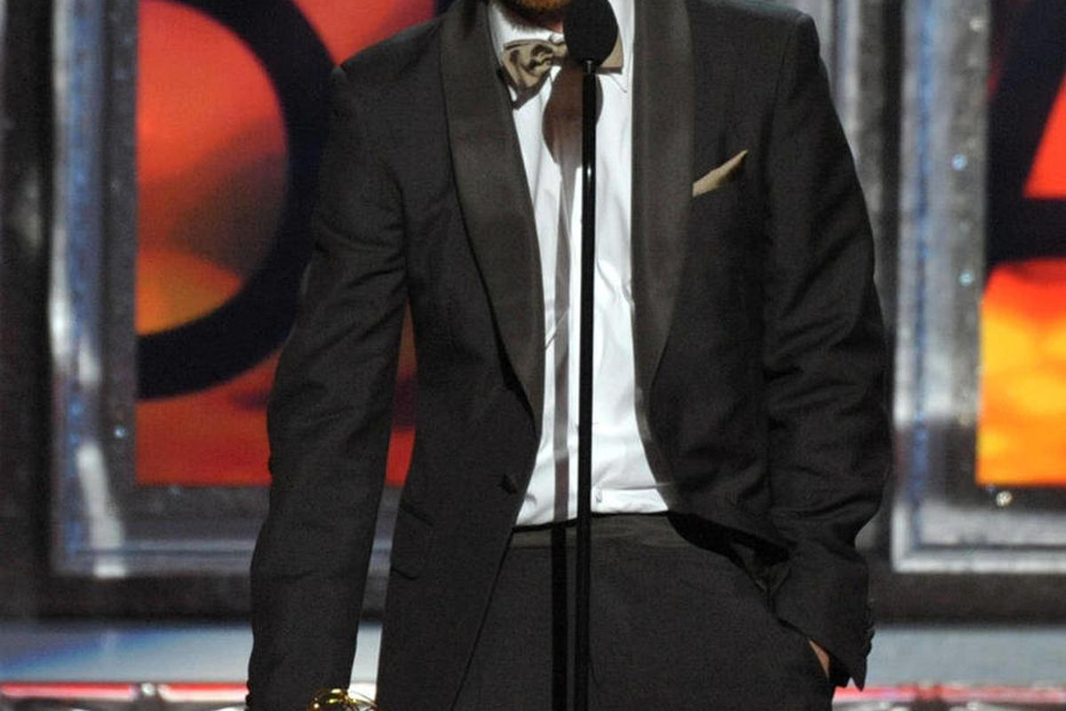 """Aaron Paul accepts the award for Outstanding Supporting Actor in a Drama Series for """"Breaking Bad"""" at the 64th Primetime Emmy Awards at the Nokia Theatre on Sunday, Sept. 23, 2012, in Los Angeles."""