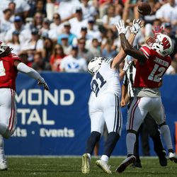Brigham Young Cougars linebacker Christian Folau (31) breaks up a pass intended for Wisconsin Badgers quarterback Alex Hornibrook (12) during the game at LaVell Edwards Stadium in Provo on Saturday, Sept. 16, 2017.