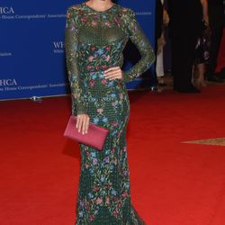 Emily Ratajkowski wears a Monique Lhuillier dress and Brian Atwood heels.