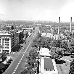 View from the Hotel Utah looking west in 1945 shows part of Temple Square and the Union Pacific Depot at the end of the street.