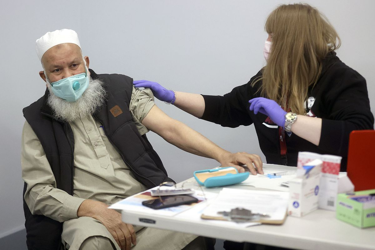 Ali Mir Hamid, 72, prepares to get a Moderna COVID-19 vaccination from Kimberly Desmond, a registered nurse with the Salt Lake County Health Department, at the Utah Islamic Center in West Jordan on Thursday, March 18, 2021.