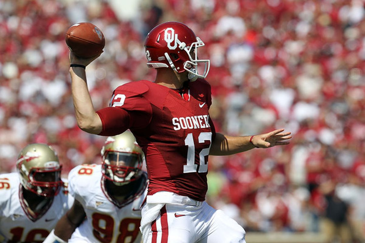 NORMAN OK - SEPTEMBER 11:  Quarterback Landry Jones #12 of the Oklahoma Sooners drops back to pass against the Florida State Seminoles.  (Photo by Ronald Martinez/Getty Images)