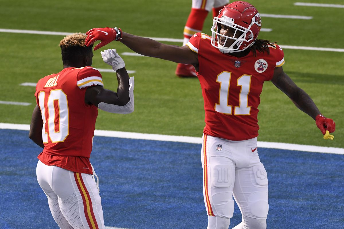 Kansas City Chiefs wide receiver Tyreek Hill reacts with wide receiver Demarcus Robinson against the Los Angeles Chargers during the fourth quarter at SoFi Stadium.