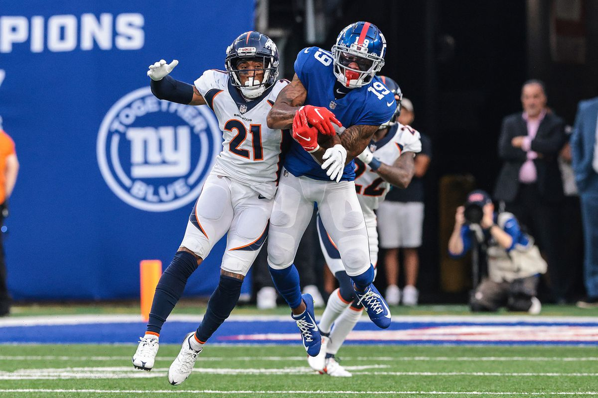 New York Giants wide receiver Kenny Golladay (19) catches the ball over Denver Broncos cornerback Ronald Darby (21) during the second half at MetLife Stadium. Mandatory Credit: Vincent Carchietta