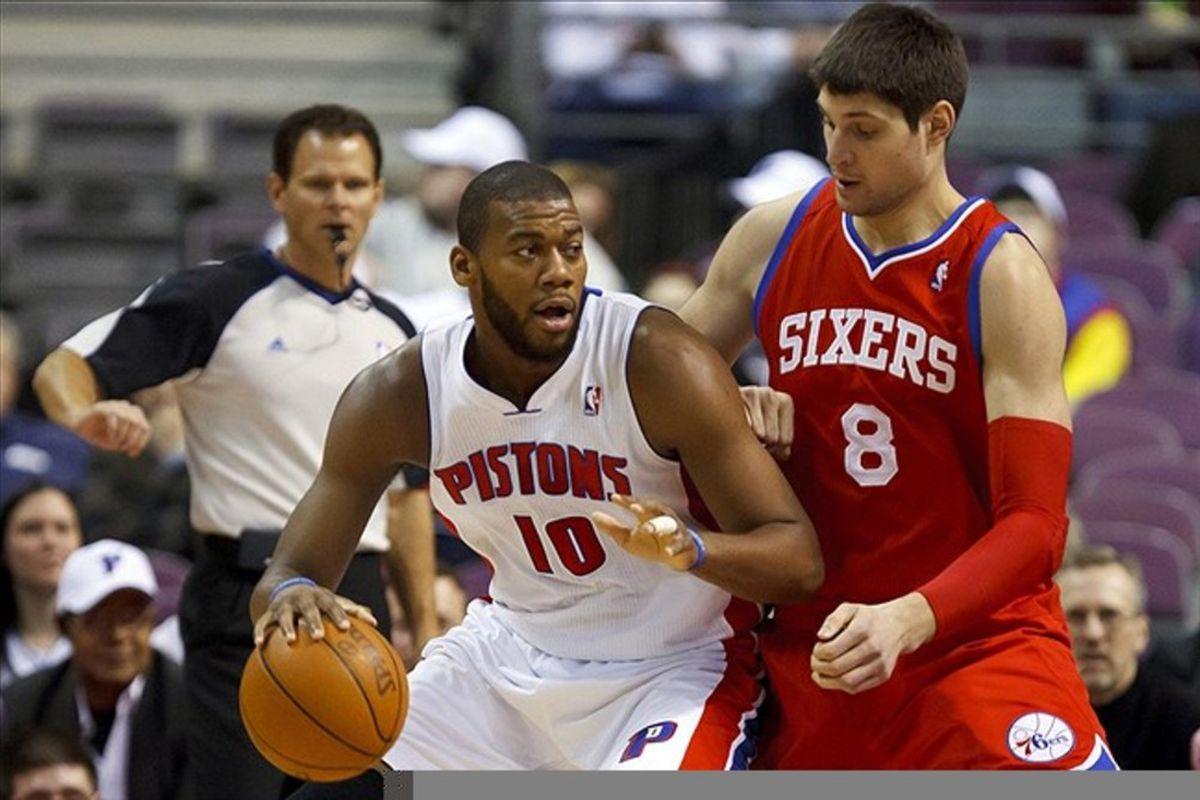 Feb. 28, 2012; Auburn Hills, MI, USA; Detroit Pistons center Greg Monroe (10) is defended by Philadelphia 76ers center Nikola Vucevic (8) in the first quarter at The Palace. Mandatory Credit: Rick Osentoski-US PRESSWIRE