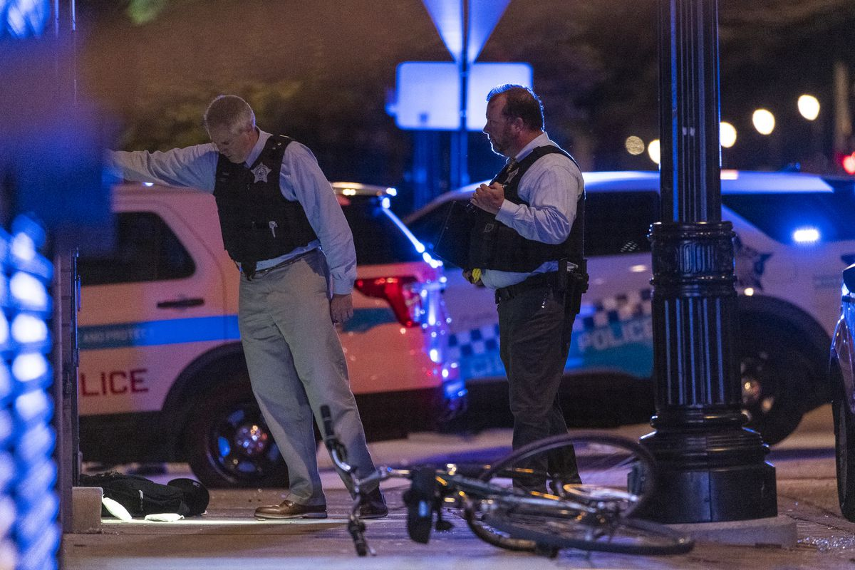 Chicago police work the scene where at least six people were shot in the 2000 block of East 71st Street in the South Shore neighborhood, late Sunday, June 27, 2021, in Chicago.