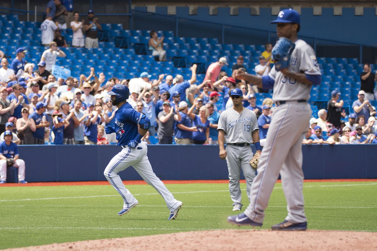 Aug 1, 2015; Toronto, Ontario, CAN; Toronto Blue Jays right fielder Jose Bautista (19) runs the bases after hitting a home run on Kansas City Royals starting pitcher Yordano Ventura (30) during the fifth inning in a game at Rogers Centre.