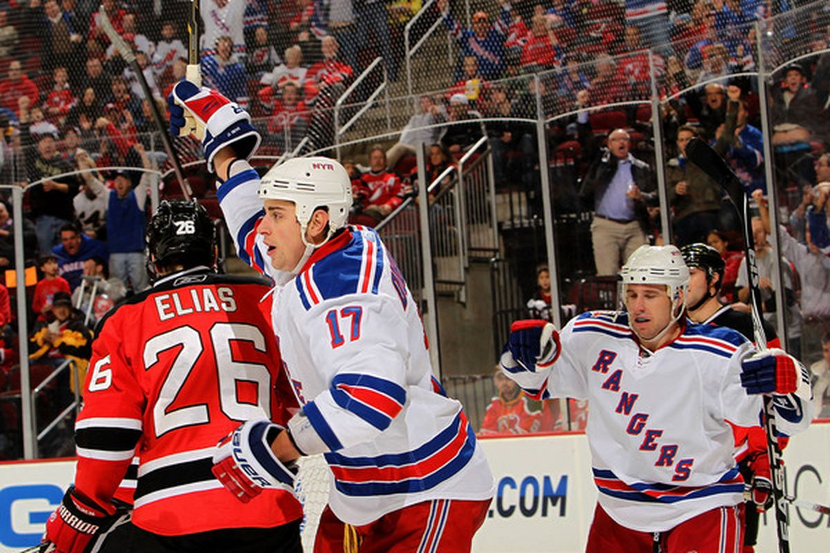 Brandon Dubinsky (17) of the New York Rangers celebrates scoring the third goal against the New Jersey Devils at the Prudential Center on November 5 2010 in Newark New Jersey.  (Photo by Nick Laham/Getty Images)