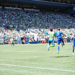 Captain Drew Moor heads another ball out of the box, easily beating Servando Carrasco on the play.