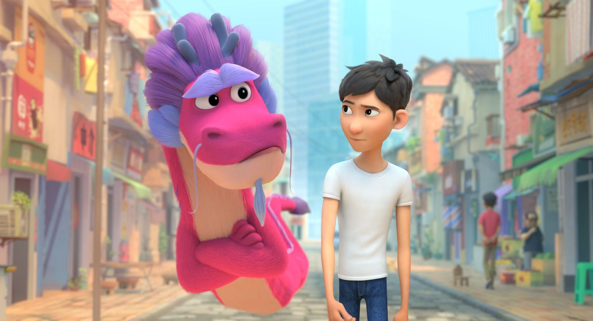 a boy and a pink dragon