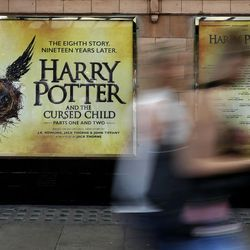 """In this photo taken on Thursday, July 28, 2016, pedestrians pass a poster advertising the new Harry Potter play, at the Palace Theatre in London. Nine years after J.K. Rowling's final novel about the boy wizard, Harry has returned, on the stage and the page - and he's still producing commercial alchemy. """"Harry Potter and the Cursed Child,"""" a two-part stage drama that picks up 19 years after the novels ended, has its gala opening Saturday at London's Palace Theatre, and is all-but sold out through December 2017. (AP Photo/Kirsty Wigglesworth)"""