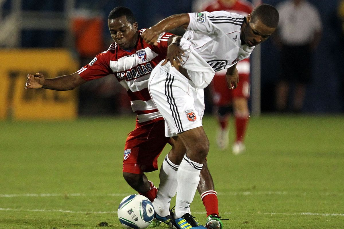FRISCO, TX - JULY 16:  Marvin Chavez #18 of the FC Dallas dribbles the ball against Ethan White #15 of the D.C. United at Pizza Hut Park on July 16, 2011 in Frisco, Texas.  (Photo by Ronald Martinez/Getty Images)