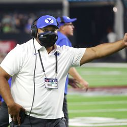 Brigham Young Cougars head coach Kalani Sitake talks with the referee during the Vegas Kickoff Classic in Las Vegas on Saturday, Sept. 4, 2021.