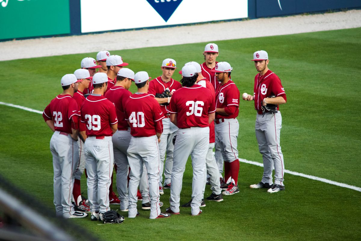 Team gathering in the outfield before the game against ORU