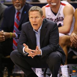 Gonzaga Bulldogs head coach Mark Few talks to his players on the floor as BYU and Gonzaga play in an NCAA basketball game in the Marriott Center in Provo on Saturday, Feb. 24, 2018. Gonzaga won 79-65.