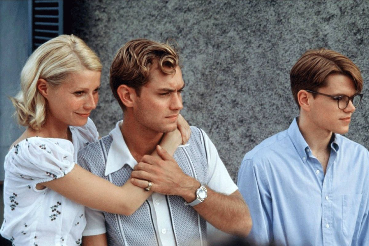 Marge (Paltrow) and Dickie (Law) embrace as Ripley (Damon) stands next to them.