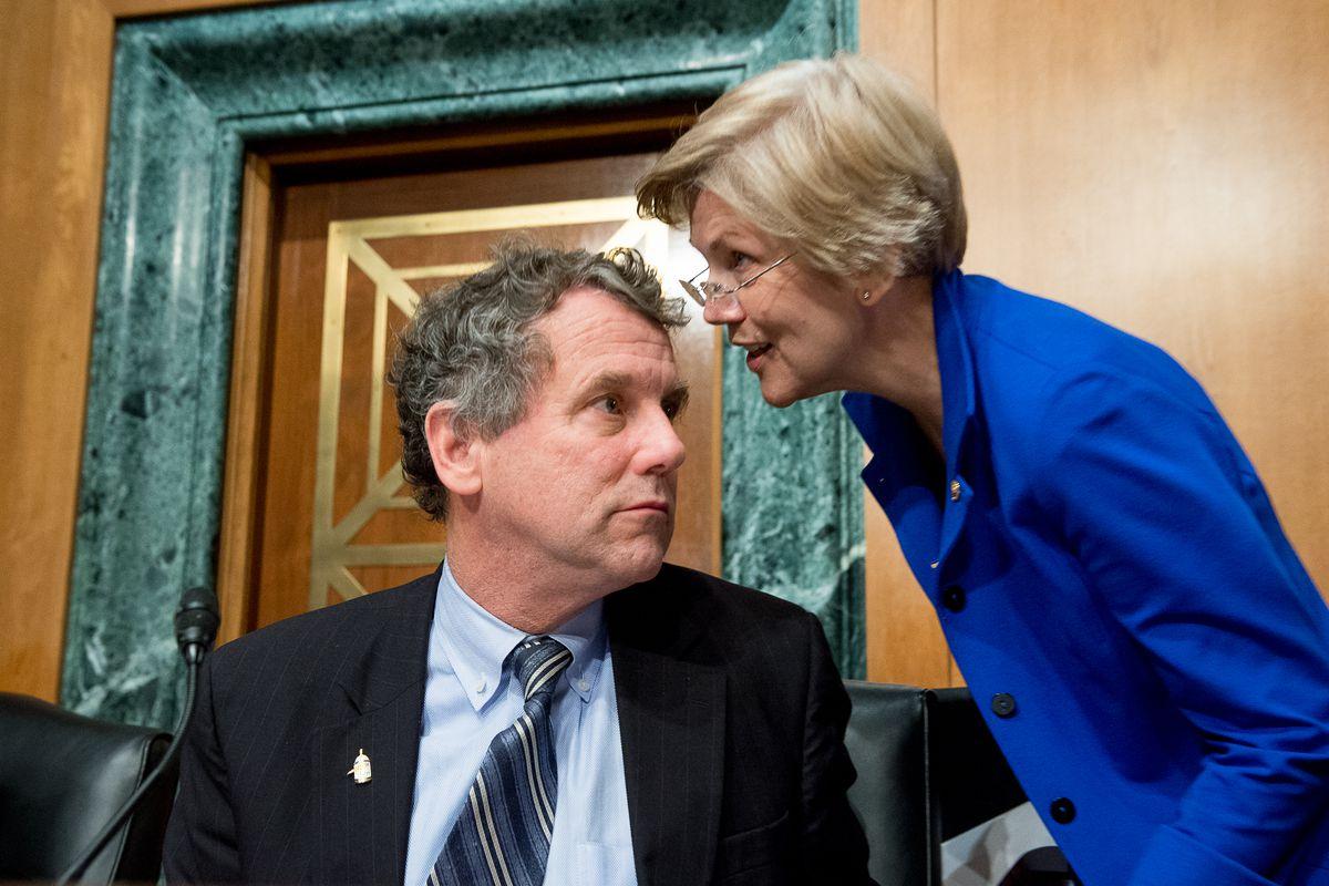 Elizabeth Warren and Sherrod Brown talking to each other.