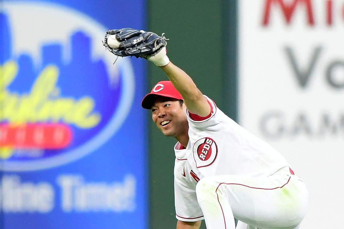 Shogo Akiyama #4 of the Cincinnati Reds celebrates after making a sliding catch for the third out of the fifth inning during their game against the Miami Marlins at Great American Ball Park