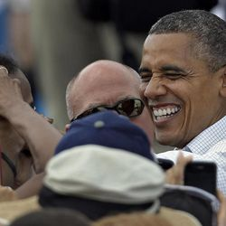 President Obama laughs as he greets supporters after speaking at a campaign rally Saturday, Sept. 8, 2012, in Seminole, Fla.
