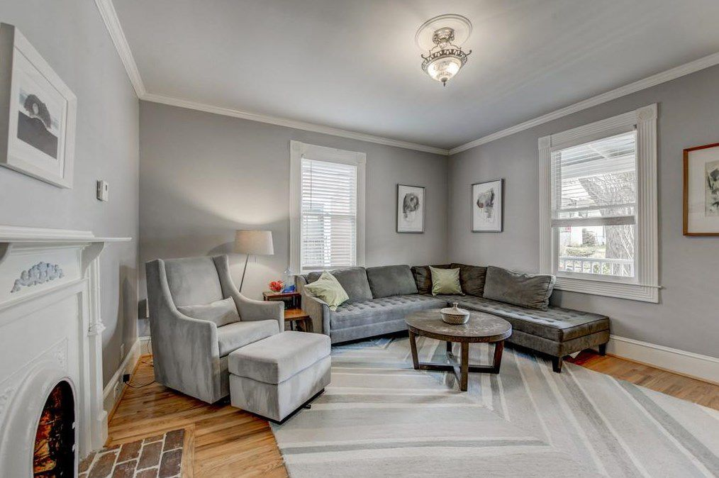 A big gray living room with a sectional couch.