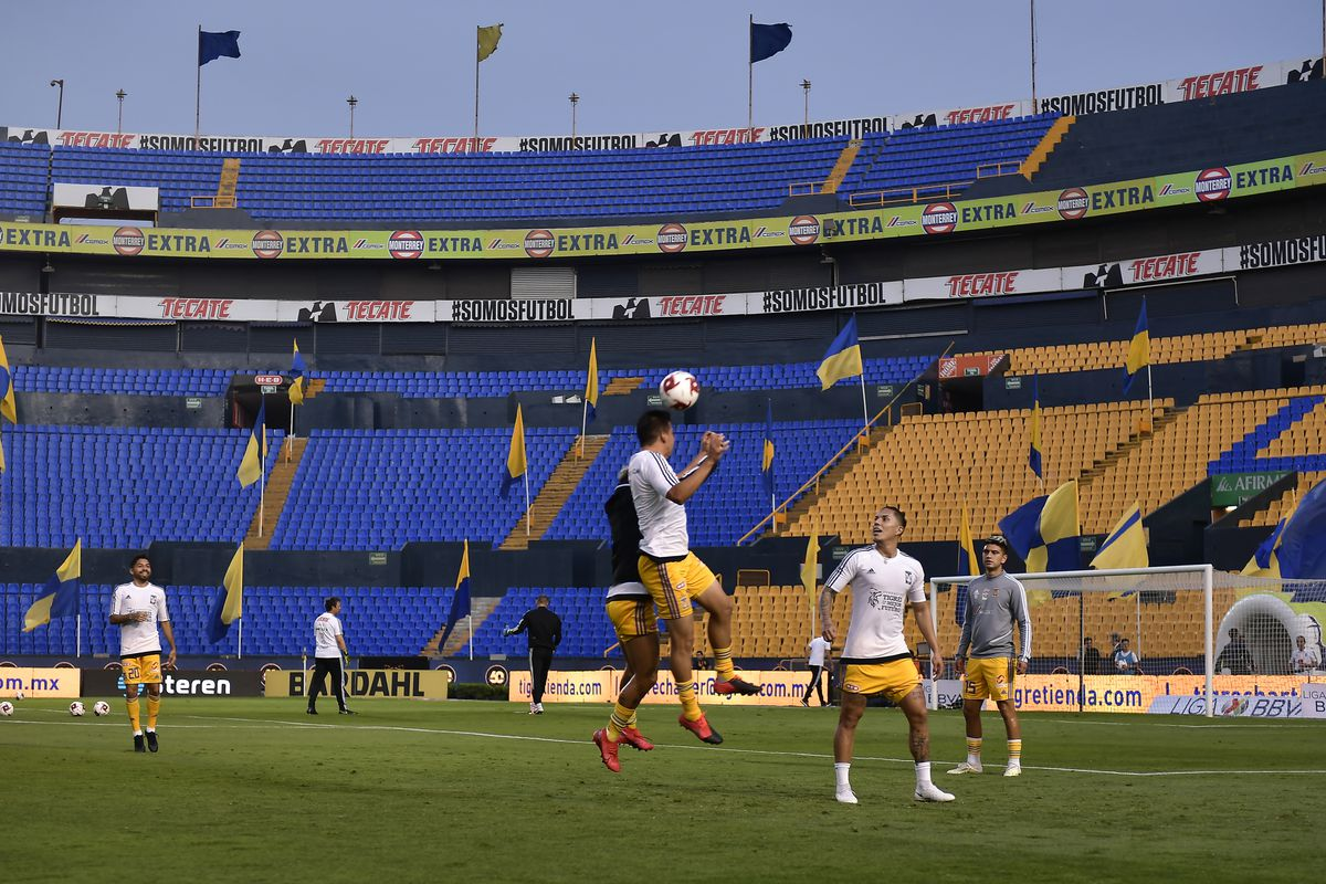 Players of Tigres warm up in an empty stadium prior to the 10th round match between Tigres UANL and FC Juarez as part of the Torneo Clausura 2020 Liga MX at Universitario Stadium on March 14, 2020 in Monterrey, Mexico. The match is played behind closed doors to prevent the spread of the novel Coronavirus (COVID-19).