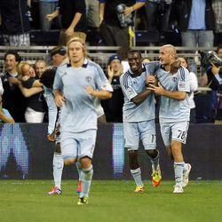 KANSAS CITY, KS - APRIL 14:  Aurelien Collin #78 of Sporting Kansas City is congratulated after scoring during the Major League Soccer game against  Real Salt Lake on April 14, 2012 at Livestrong Sporting Park in Kansas City, Kansas.  (Photo by Jamie Squire/Getty Images)