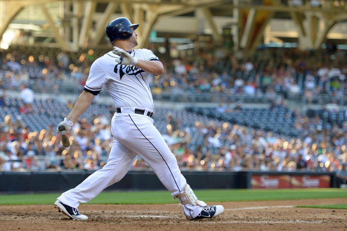 San Diego, CA, USA; San Diego Padres first baseman Yonder Alonso (23) hits an RBI single during the eighth inning against the Atlanta Braves at Petco Park. Mandatory Credit: Jake Roth-US PRESSWIRE