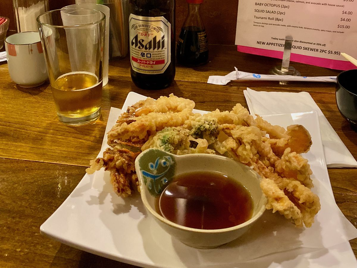 A plate of tempura with ponzu dipping sauce