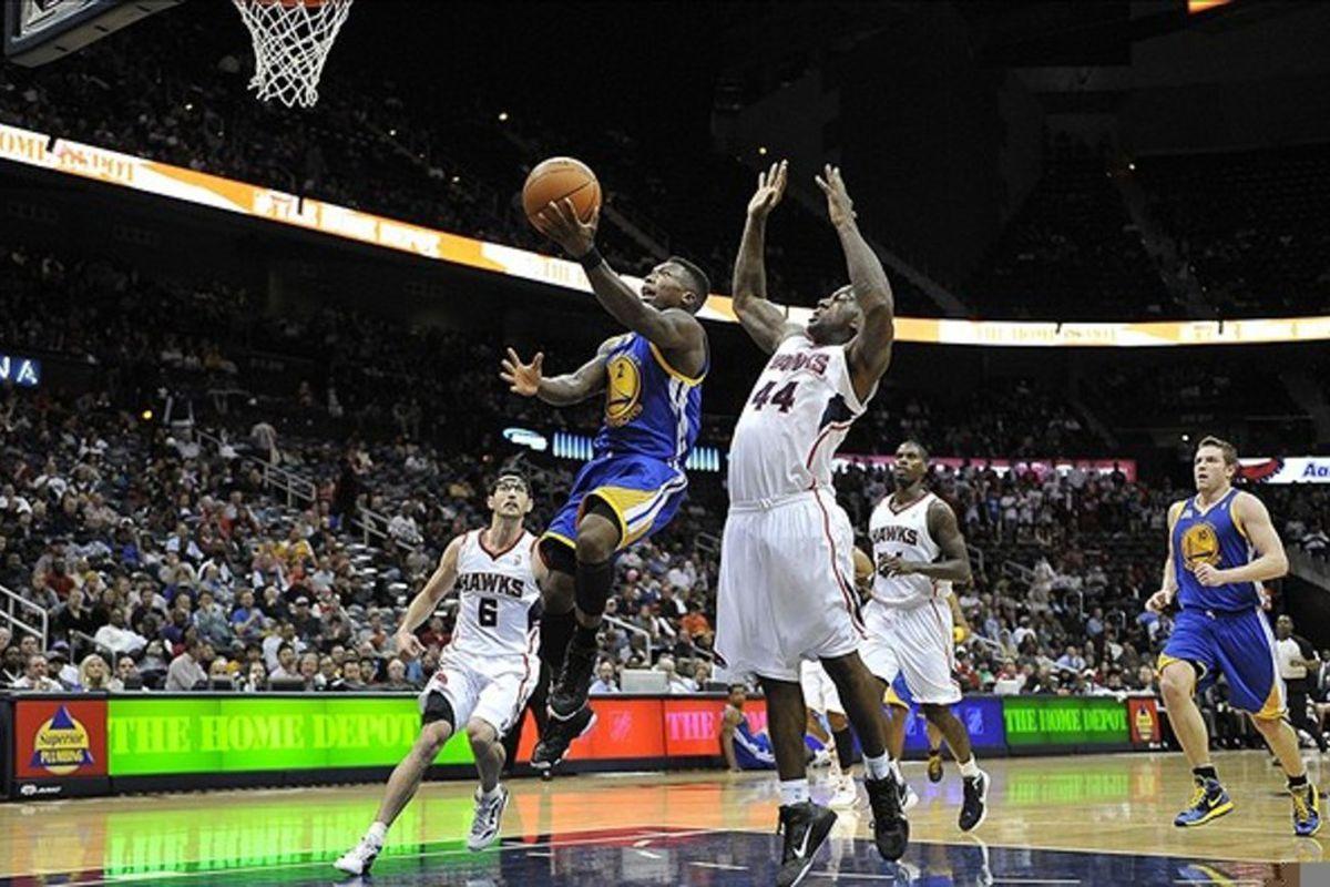 Feb 29, 2012; Atlanta, GA, USA; Golden State Warriors point guard Nate Robinson (2) drives to the basket against Atlanta Hawks forward Ivan Johnson (44) at Philips Arena. Mandatory Credit: Paul Abell-US PRESSWIRE