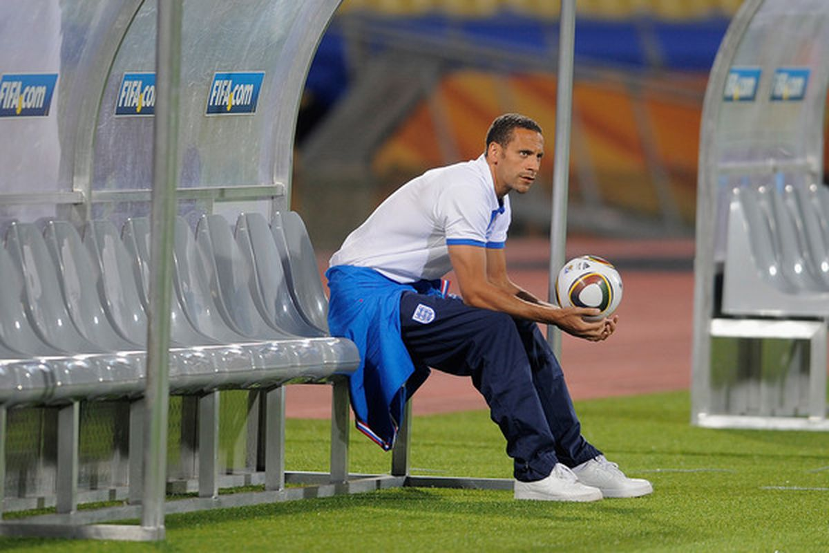 RUSTENBURG, SOUTH AFRICA - JUNE 11:  Rio Ferdinand of England looks on from the bench during the England training session at the Royal Bafokeng Stadium on June 11, 2010 in Rustenburg, South Africa.  (Photo by Michael Regan/Getty Images)