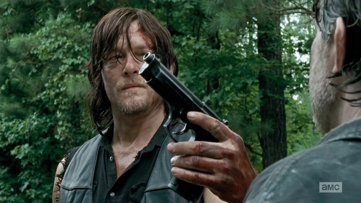Daryl turns over his gun on The Walking Dead.