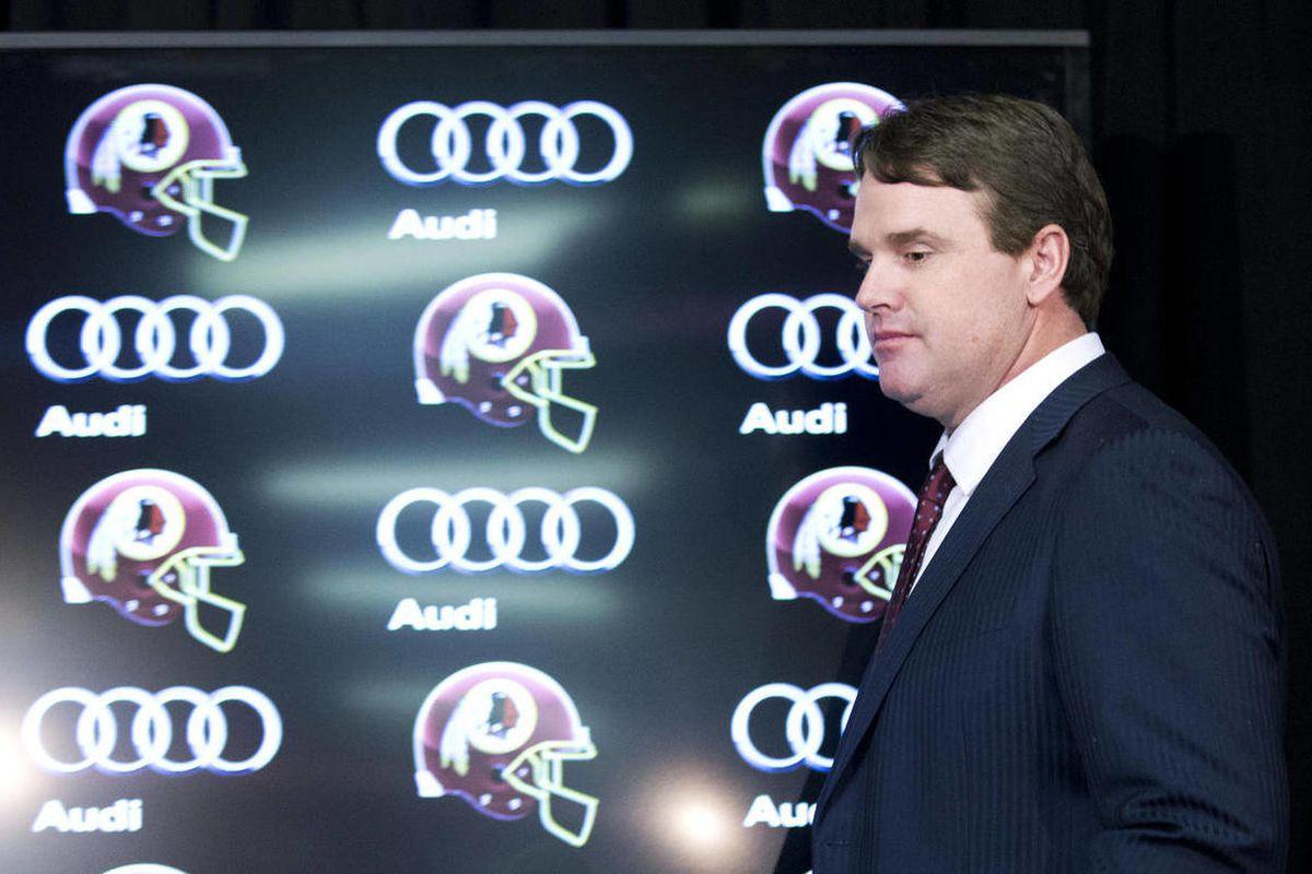 Washington Redskins head coach Jay Gruden, arrives for a news conference at the Redskins Park in Ashburn, Va., Thursday, Jan. 9, 2014.