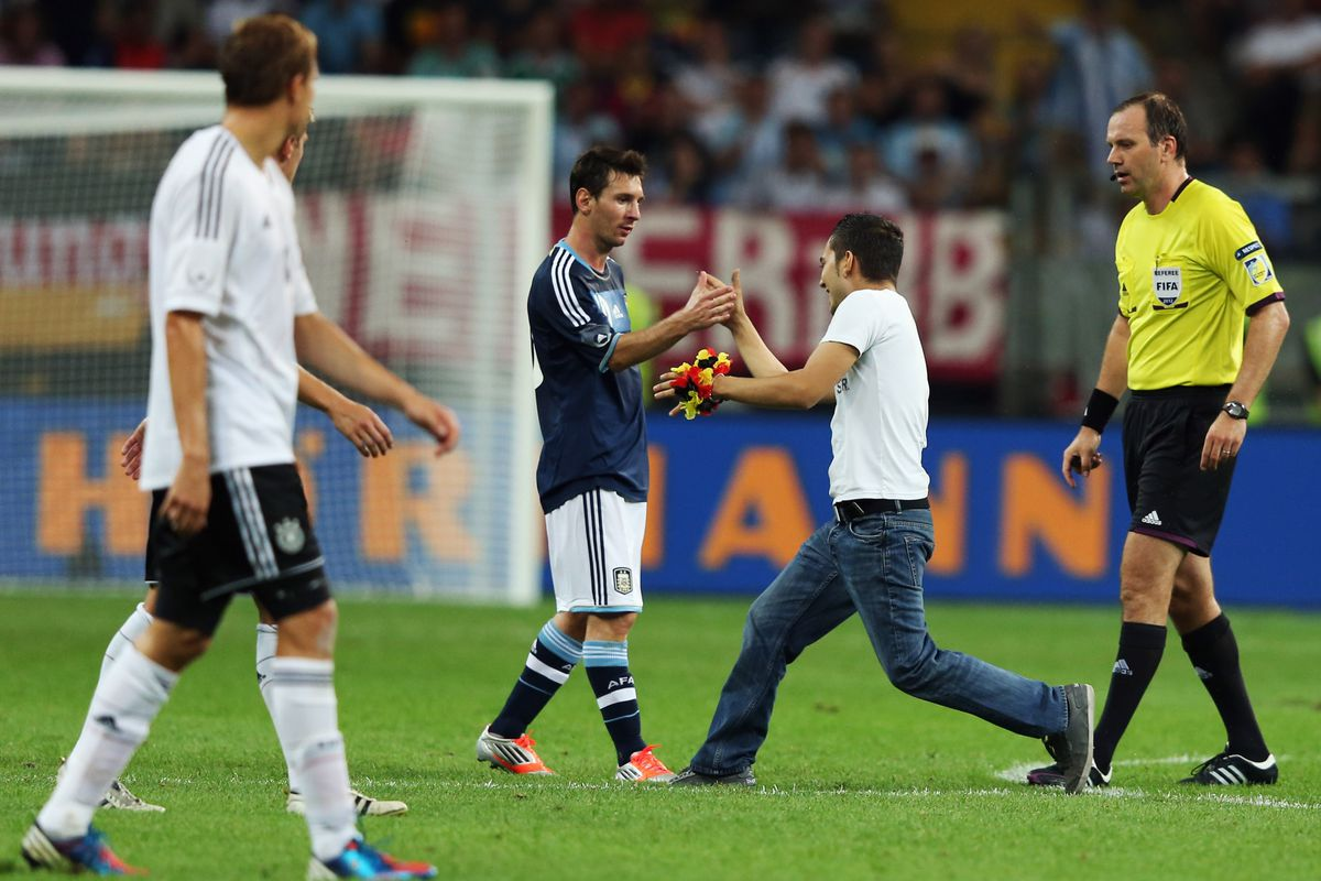 Messi is even friendly to pitch invaders.